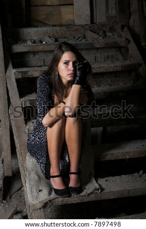 girl on the stair in the dark ruin