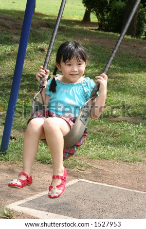 Girl on the swing - stock photo