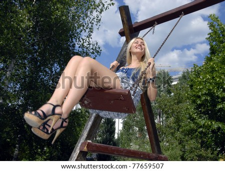 Girl on the swing - stock photo
