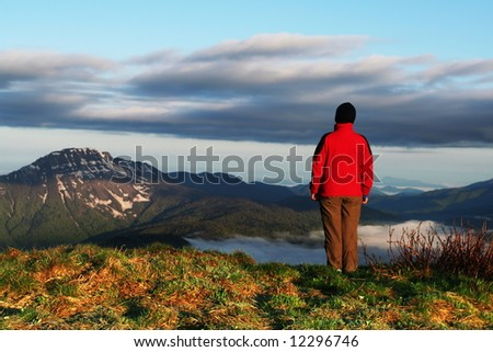 Girl on the top of mountain - stock photo
