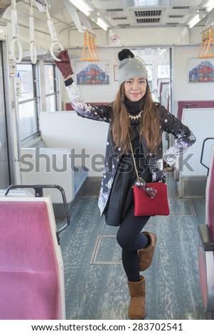 Girl on the train at fujikawaguchiko,Japan - stock photo