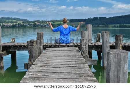 Girl on the wooden jetty - stock photo