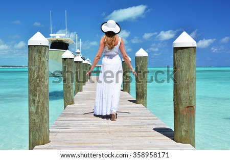 Girl on the wooden jetty. Great Exuma, Bahamas - stock photo