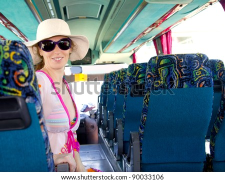 Girl on tourist bus happy with sunglasses in summer vacations - stock photo