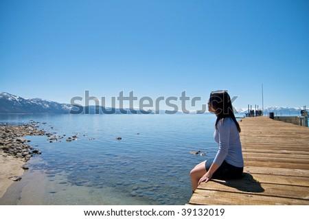 Girl on vacation at a lake - stock photo