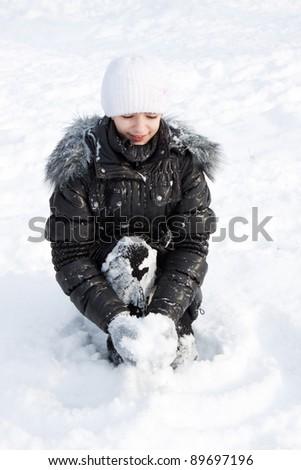 girl on white snow - stock photo