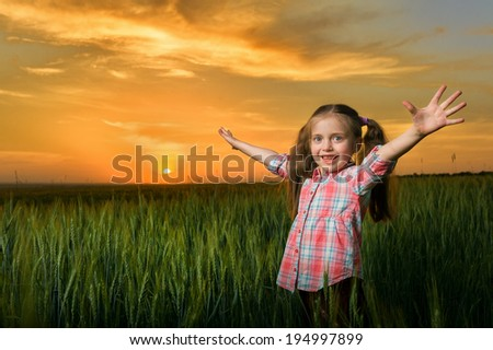 girl open arms at sunset - stock photo
