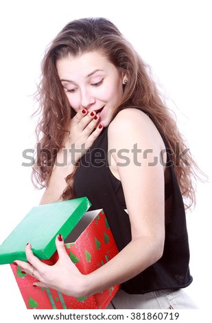 girl opens a gift - stock photo
