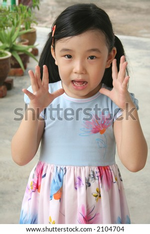 Girl opens up both hand showing shocked expression - stock photo