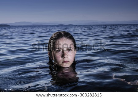Girl out of the sea with wet hair and skin