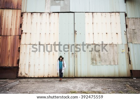 girl out side the iron house - stock photo