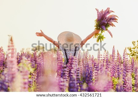 Girl Outdoor enjoying nature. Beautiful woman in hat on the Summer Field - stock photo