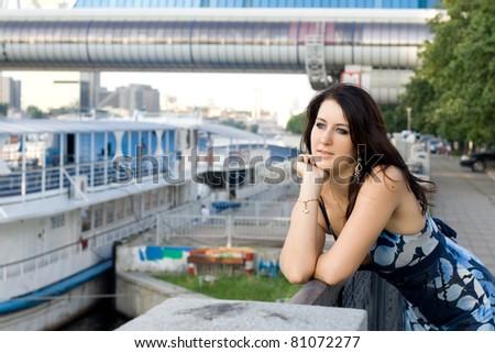 Girl outdoor on embankment - stock photo
