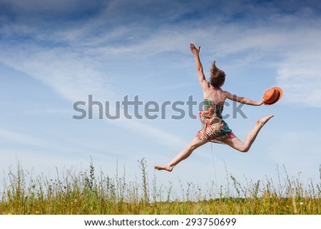 Girl Outdoors enjoying nature. Fun jump ) Summer time - stock photo