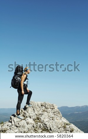 Girl overview landscapes in mountain - stock photo