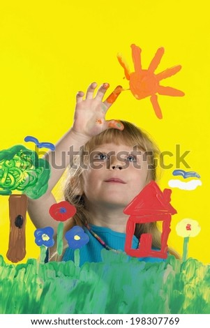 Girl Painting On Glass - stock photo