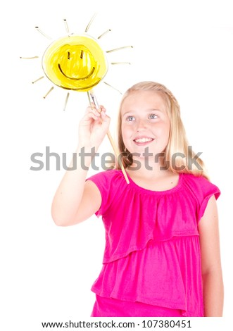 Girl painting sun on a window, isolated on white - stock photo