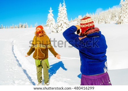 Girl photo of a man in a beautiful mountain snowy landscape