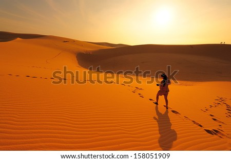 Girl Photographer in Sunrise Desert