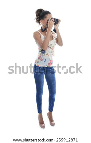 Girl-photographer takes snaps, isolated on white