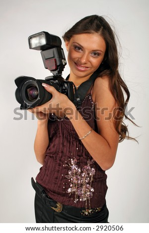 Girl - photographer with pro camera in hands - stock photo