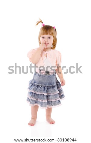 girl picks in a nose on a light background. - stock photo