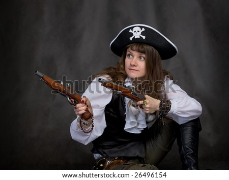 Girl - pirate on black with two pistols in hands - stock photo