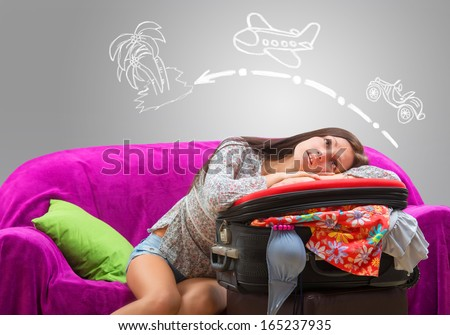 Girl planning her journey to the tropical island by car and by airplane - stock photo