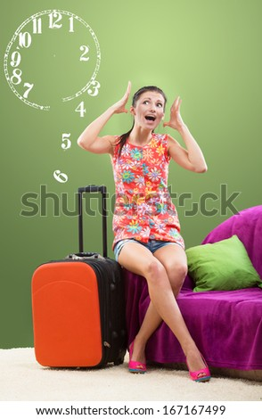 Girl planning her travel during peak season, limited time concept - stock photo