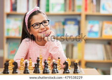 Girl play chess in school