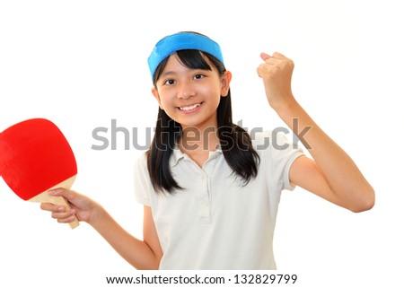 Girl play table tennis. - stock photo