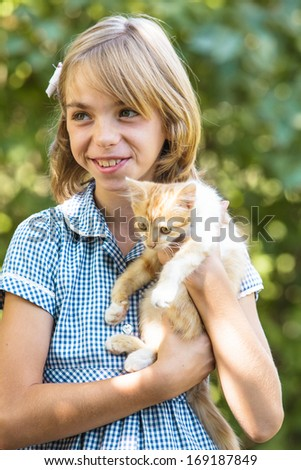 Girl play with kitten - stock photo