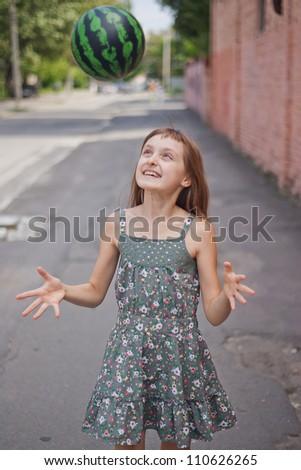Girl playing ball - stock photo