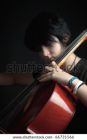 girl playing cello - stock photo