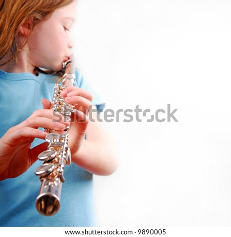 Girl Playing Flute - stock photo