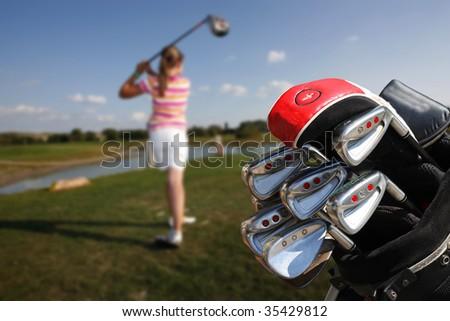 girl playing golf - stock photo
