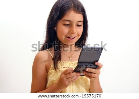 Girl playing hand-held video game