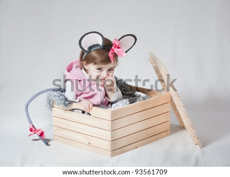 girl playing in the box - stock photo