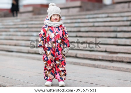 Girl playing in the street in winter
