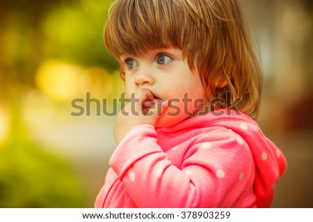 girl playing in the street. sunlight. - stock photo