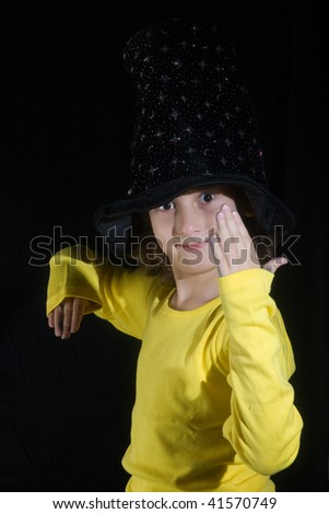 girl playing on a  black background - stock photo
