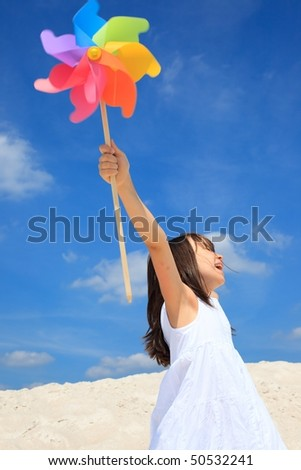 Girl playing on beach - stock photo