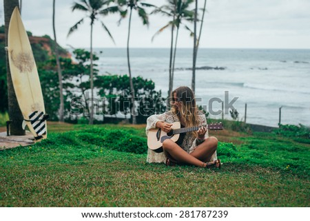 Girl playing on the guitar
