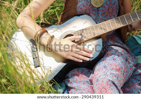 girl playing on the guitar  - stock photo