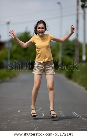 Girl playing outdoor - stock photo