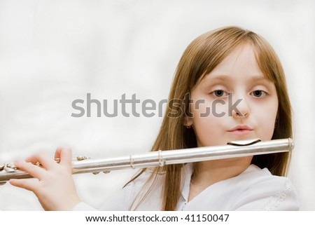 Girl Playing Silver Flute - stock photo