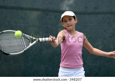 Girl playing tennis - stock photo