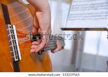 girl playing the guitar - stock photo