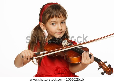 Girl playing the violin over white background - stock photo