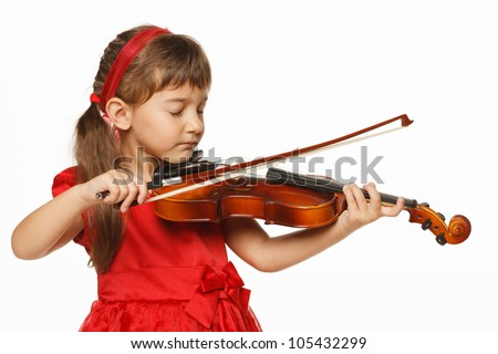 Girl playing the violin with closed eyes, over white background - stock photo